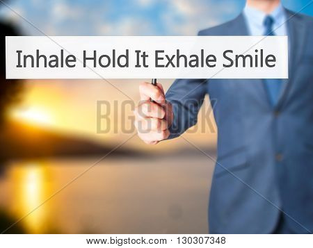 Inhale Hold It Exhale Smile - Businessman Hand Holding Sign