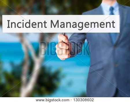 Incident Management - Businessman Hand Holding Sign