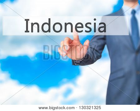 Indonesia - Businessman Hand Pressing Button On Touch Screen Interface.