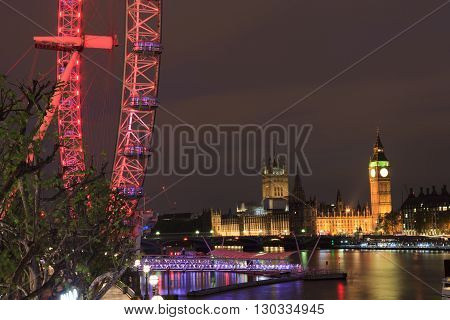 LONDON UNITED KINGDOM - 18 MAY 2016: London Eye is the tallest Ferris wheel in Europe Big Ben and Westminster Abbey in London United Kingdom