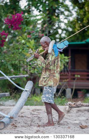 Bunaken, Indonesia - April, 5 2014 - Fisherman Returning To Hut Village