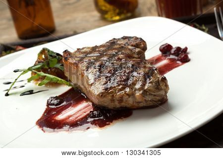 Fat juicy steak beef thick edge grain-fed wet binning. Served with red wine sauce. poster