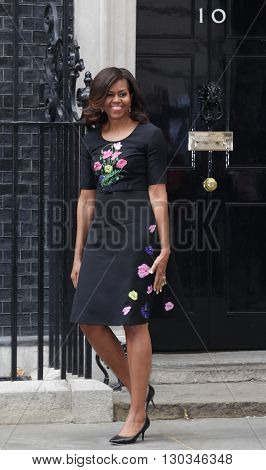 LONDON, UK  - JUN 16, 2015: Michelle Obama seen leaving 10 Downing street after visiting David and Samantha Cameron