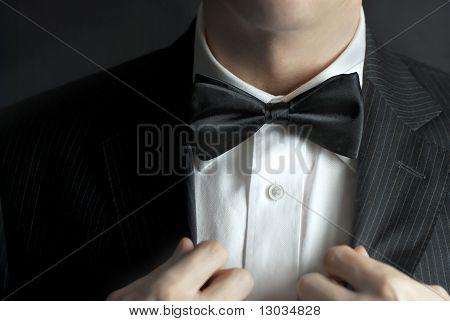 Man Straightens Tux