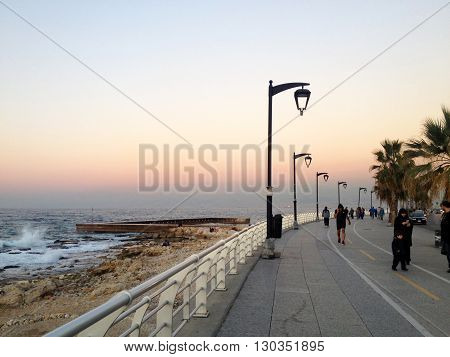 Beirut, Lebanon -  December 24, 2015: People take their sunset walk on the famous Corniche (seaside promenade) in Beirut, Lebanon
