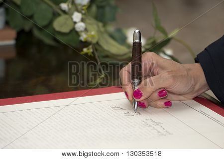 Hand While Signin For Wedding