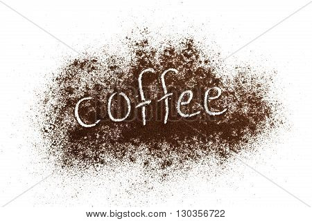 The word coffee written against scattered natural coffee isolated on a white background