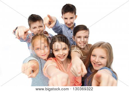 childhood, fashion, friendship and people concept - happy smiling children pointing finger to you