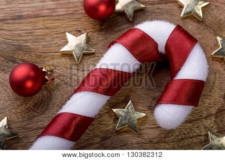 christmas candycane with red ribbon, gold star and red christmas balls