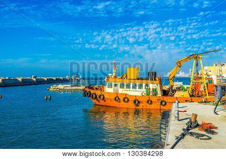 The old fishing trawler moored in industrial port of Jaffa Tel Aviv Israel.