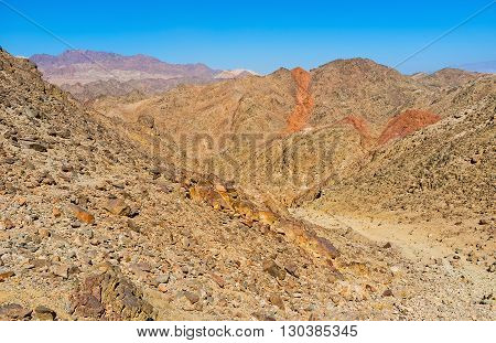 The narrow path among the steep rocky slopes leads to Zefahot Mount Eilat Israel.