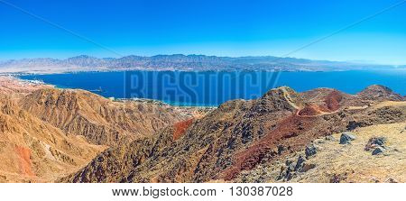 The scenic colorful landcape of Eilat mountains with Aqaba Gulf in the distance Israel.