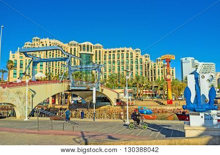 EILAT ISRAEL - FEBRUARY 23 2016: The Memorial drawbridge across Lagoona with the Hilton Hotel Complex on the background on February 23 in Eilat.