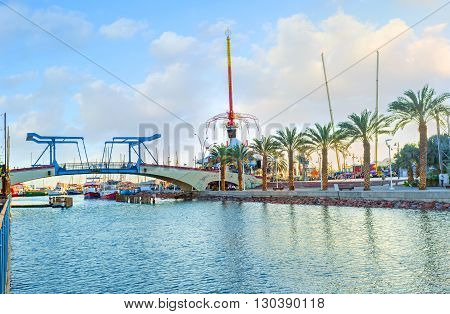 EILAT ISRAEL - FEBRUARY 23 2016: The modern promenade leads to the drawbridge and central amusement park on February 23 in Eilat.