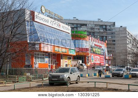 MOSCOW - MARCH 29: Shops homes and cars on Leskova Street on March 29 2016 in Moscow. Leskova Street is in North-Eastern Administrative Okrug of Moscow.