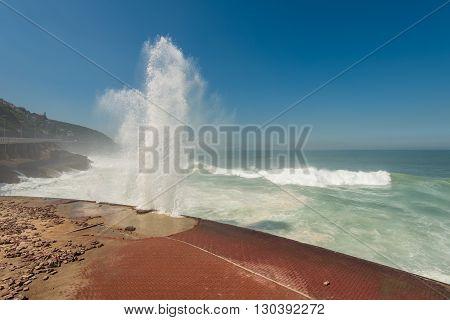 Strong Waves Crashing into Sao Conrado beach promenade in Rio de Janeiro, Brazil