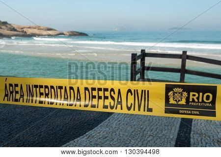 RIO DE JANEIRO, BRAZIL - MAY 7, 2016: Arpoador beach is fenced with tape by Civil Defense because of the waves of a strong undertow.