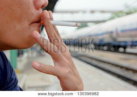 The Man smoking cigarette because stress.
