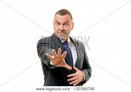 Alarmed Businessman Holding Out His Splayed Hand