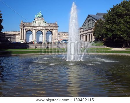 BRUSSELS-OCT. 1: The Triumphal Arch and Royal Museum of the Armed Forces and of Military History are seen in Parc du Cinquantenaire Park in Brussels Belgium on October 1 2015.