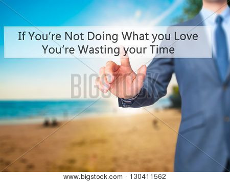 If You're Not Doing What You Love You're Wasting Your Time - Businessman Hand Pressing Button On Tou