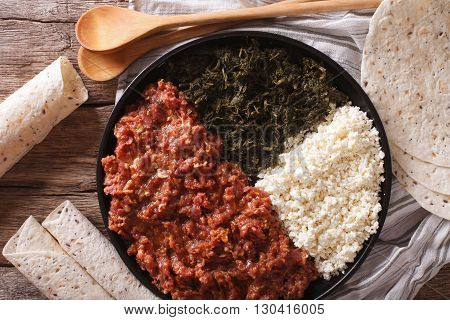 Ethiopian Kitfo: Marinated Beef With Herbs And Cheese Close-up And Injera. Horizontal Top View