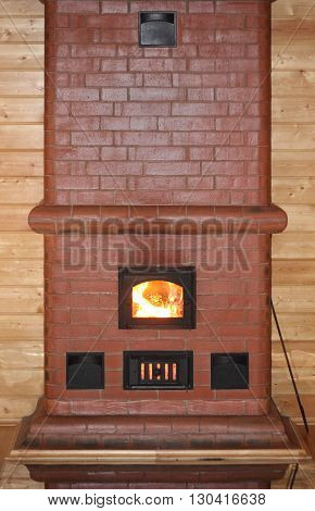 Brick oven with fire in the furnace door photo