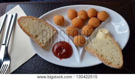 Breaded mozzarella cheese balls. Arancine. Italian food.