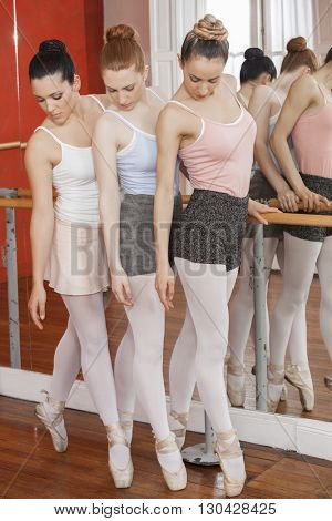 Full Length Of Ballet Dancers Performing Pointe
