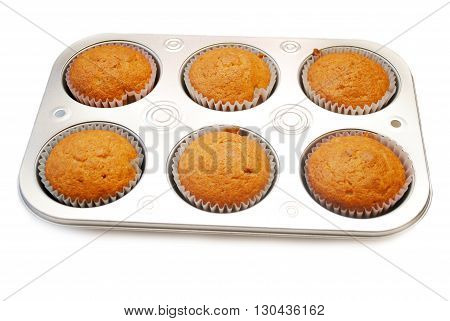 Corn Muffins Cooling in a Baking Tin Isolated Over White