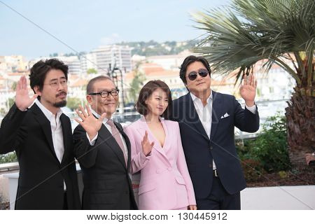 Kwak Do Won, Chun Woo Hee and Kunimura Jun attend 'The Strangers (Goksung)' Photocall during the 69th annual Cannes Film Festival at the Palais des Festivals on May 18, 2016 in Cannes, France.