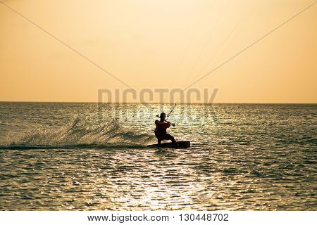 Kite surfer on Aruba island in the Caribbean at sunset