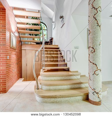 Image of stairs leading to second floor of flashy house