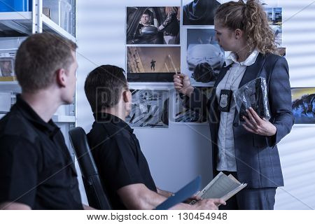 Shot of three police officers trying to solve a crime