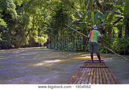 Man On River Raft Jamaica