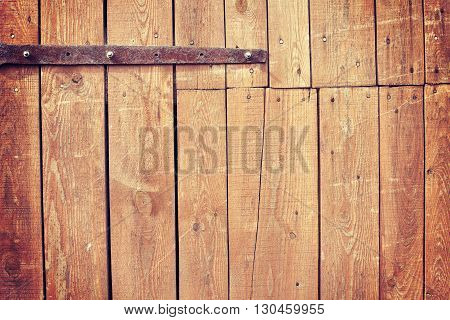 Vintage Toned Old Wooden Barn Door Background