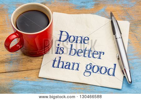 Done is better than good advice ot reminder - handwriting on a napkin with a cup of espresso coffee