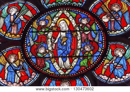 PARIS, FRANCE - MAY 31, 2015 Virgin Mary Angels Stained Glass Notre Dame Cathedral Paris France. Notre Dame was built between 1163 and 1250AD.