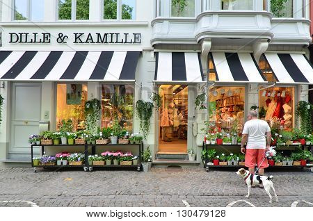 Bruges Belgium - May 11 2015: People shopping at grocery store in Bruges Belgium. Bruges is the capital and largest city of the province of West Flanders in the Fle