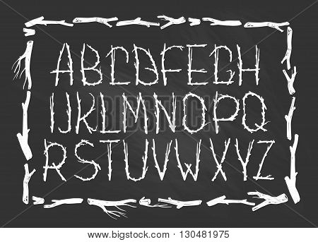 Chalk Alphabet made of branches of tree isolated on the chalkboard . Natural tribal font.