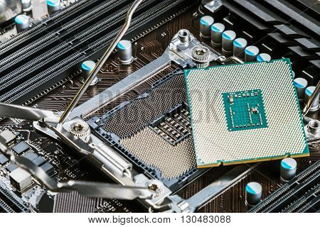 CPU socket and processor on the motherboard. Focus on the motherboard