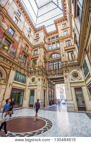 Rome, Italy - May 12, 2016: Tourists and people make shopping in the famous Galleria Alberto Sordi, the oldest shopping center, located in Piazza Colonna.