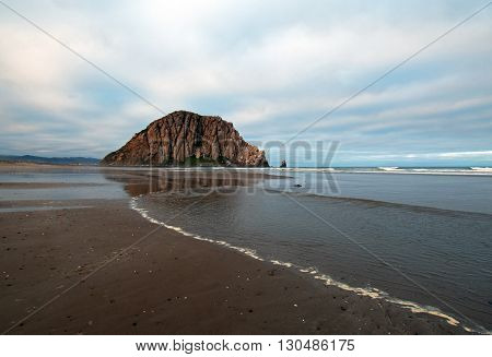 Morro Rock At Sunrise at Morro Bay State Park popular vacation / camping spot on the Central California Coast USA