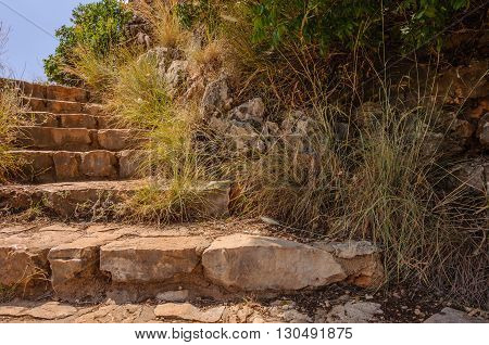 Stone stairs on a mountainside:   Staircase made of carved rocks and  stones on a mountainside, blending into the environment.