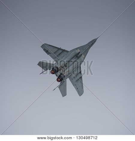 Jet fighter in flight with afterburner lit