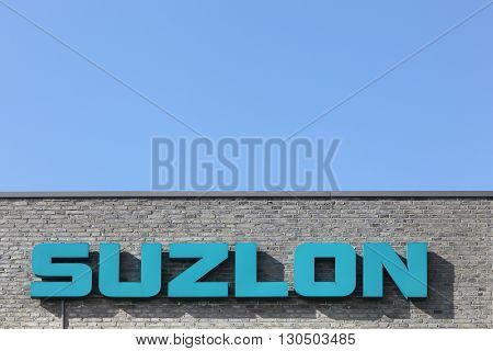 Skejby, Denmark - May 16, 2016: Suzlon logo on a wall. Suzlon Energy Limited, is a wind turbine supplier based in Pune, India. Formerly ranked as the world's fifth largest supplier