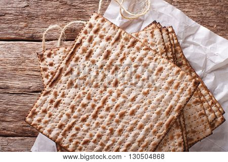 Jewish Kosher Matzo For Passover Closeup On A Wooden Table. Horizontal Top View