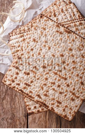 Jewish Kosher Matzo For Passover Macro On A Wooden Table. Vertical Top View