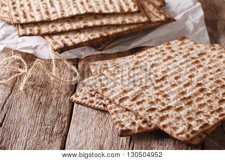 Traditional Jewish Kosher Matzo For Passover Macro On A Table. Horizontal
