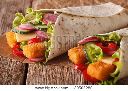 Tortilla Roll With Fish Fingers, Cheese And Vegetables Close-up. Horizontal
